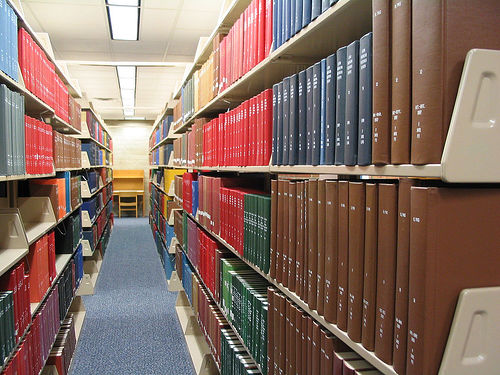 Bound journals on library shelves
