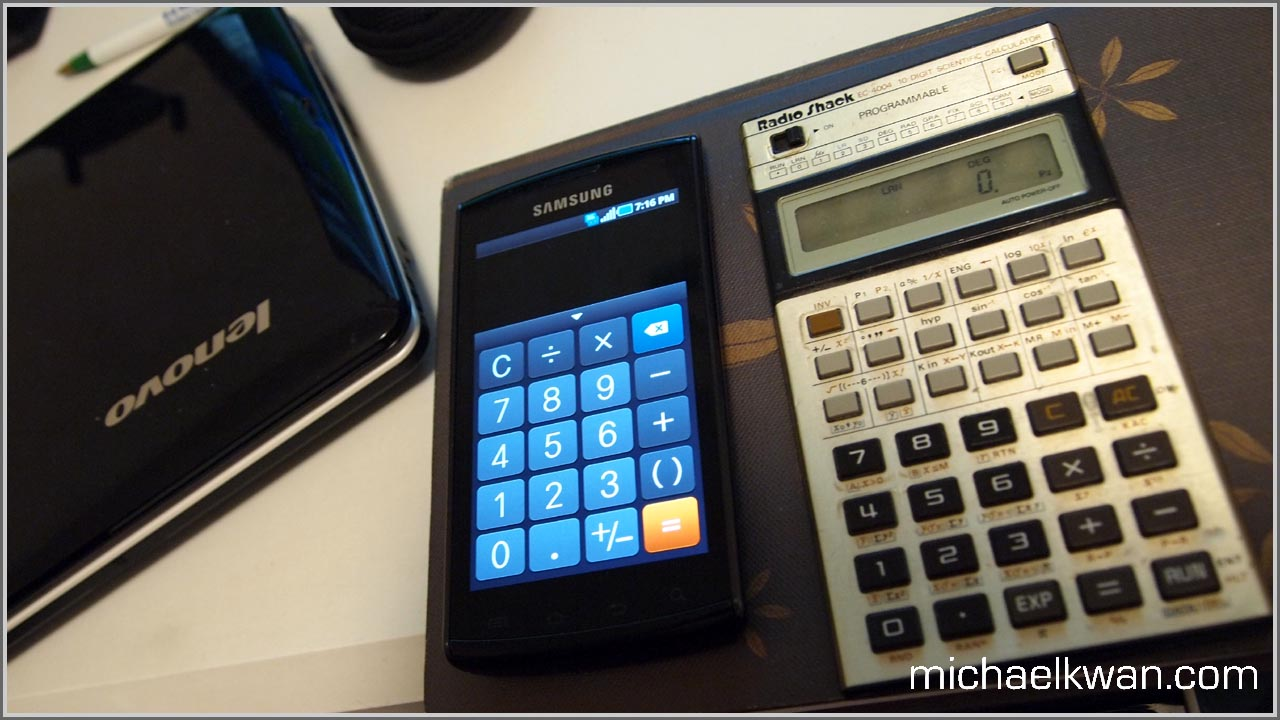 Two scientific pocket calculators on a desk.
