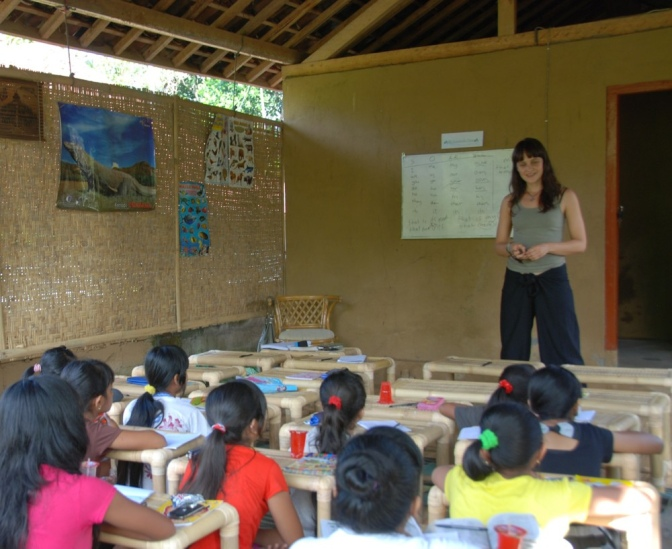 Pupils and teacher in class in a school in Bali