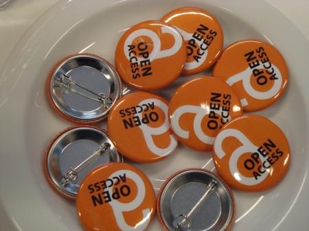 Orange badges emblazoned with the OA logo