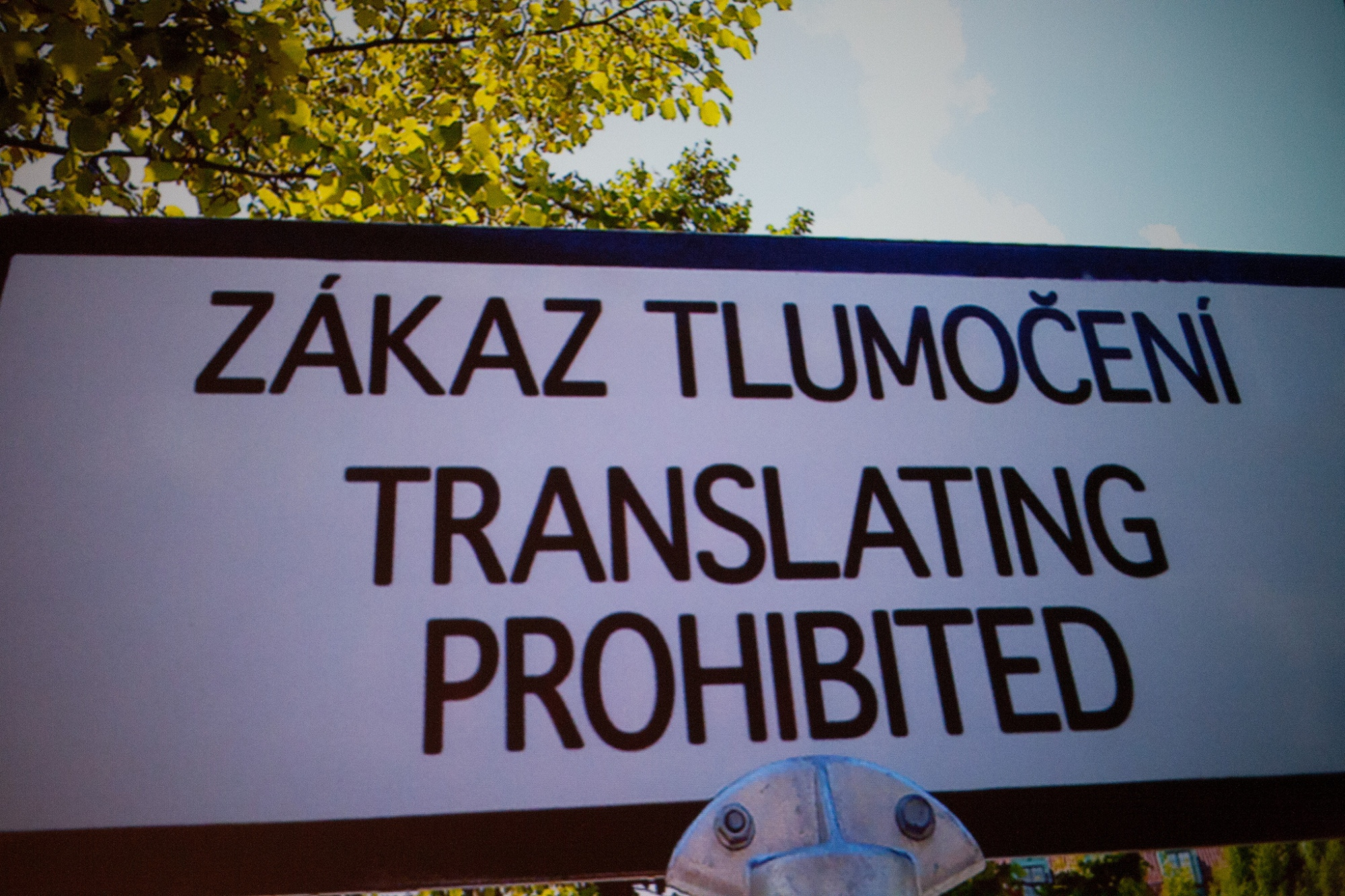 "Sign reading ""Translating prohibited"" in English and other language"