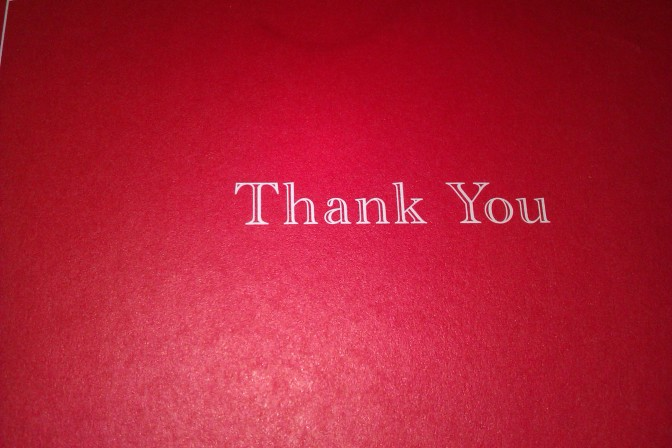Thank you (against red background)