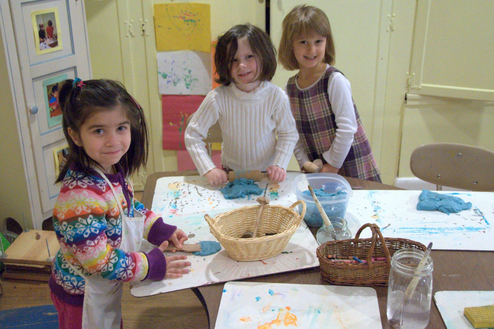 Three girls, aged around 7, engaged in craft actitivies