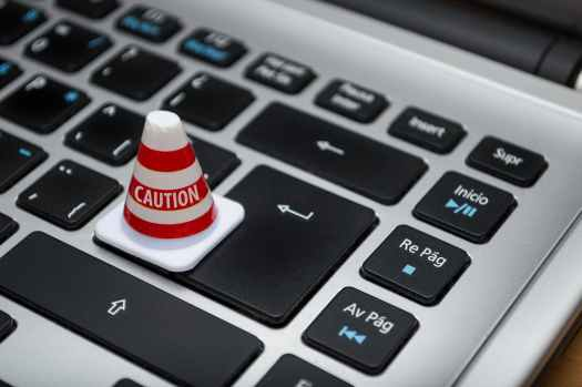 white caution cone on keyboard
